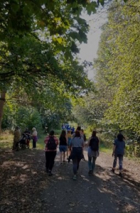 Group of charities walking under trees along the Dukes Drive, Chester